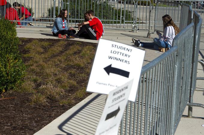 Students wait to enter the stadium before a NCAA college football game between Western Carolina and Liberty University on Saturday, Nov. 14, 2020 at Williams Stadium in Lynchburg, Va. (AP Photo/Shaban Athuman)