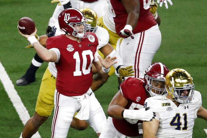 Alabama quarterback Mac Jones (10) throws from the pocket in the second half of the Rose Bowl NCAA college football game against Notre Dame in Arlington, Texas, Friday, Jan. 1, 2021. (AP Photo/Roger Steinman)