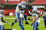 Detroit Lions strong safety Duron Harmon celebrates his interception against the Arizona Cardinals with Detroit Lions outside linebacker Christian Jones, left, during the first half of an NFL football game, Sunday, Sept. 27, 2020, in Glendale, Ariz. (AP Photo/Rick Scuteri)