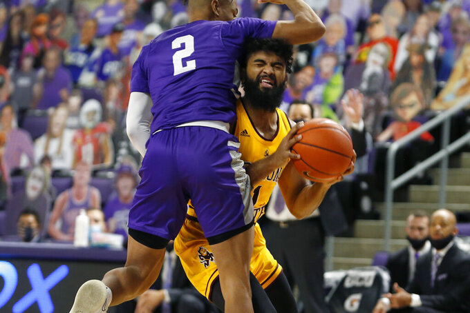 CORRECTS MONTH TO DECEMBER-Arizona State guard Remy Martin (1) is fouled by Grand Canyon's Chance McMillian (2) as he drives to the basket during the first half of an NCAA college basketball game, Sunday, Dec. 13, 2020, in Phoenix. (AP Photo/Ralph Freso)