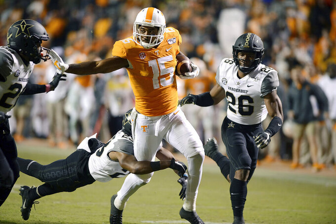 Tennessee wide receiver Jauan Jennings (15) runs through Vanderbilt defenders during the second half of an NCAA college football game Saturday, Nov. 30, 2019, in Knoxville, Tenn. (Scott Keller/The Daily Times via AP)