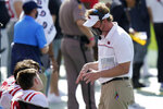 Mississippi head coach Lane Kiffin talks to his quarterbacks during the first half of the Outback Bowl NCAA college football game against Indiana Saturday, Jan. 2, 2021, in Tampa, Fla. (AP Photo/Chris O'Meara)