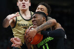 Oakland guard Kenny Pittman Jr. fouls Michigan State forward Aaron Henry (11) during the second half of an NCAA college basketball game, Saturday, Dec. 14, 2019, in Detroit. (AP Photo/Carlos Osorio)