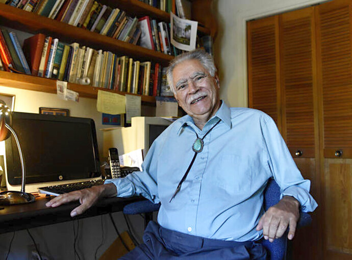 In this June 6, 2016 image, New Mexico author Rudolfo Anaya poses for a photograph in his home writing studio. Anaya, who helped launch the 1970s Chicano literature movement with his novel