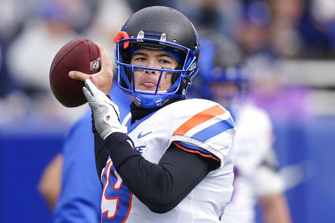 Boise State quarterback Hank Bachmeier (19) warms up before an NCAA college football game against BYU, Saturday, Oct. 9, 2021, in Provo, Utah. (AP Photo/Rick Bowmer)