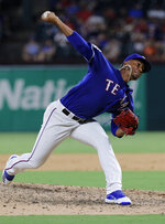 Texas Rangers relief pitcher Emmanuel Clase throws to a Minnesota Twins batter during the ninth inning of a baseball game in Arlington, Texas, Friday, Aug. 16, 2019. (AP Photo/Tony Gutierrez)