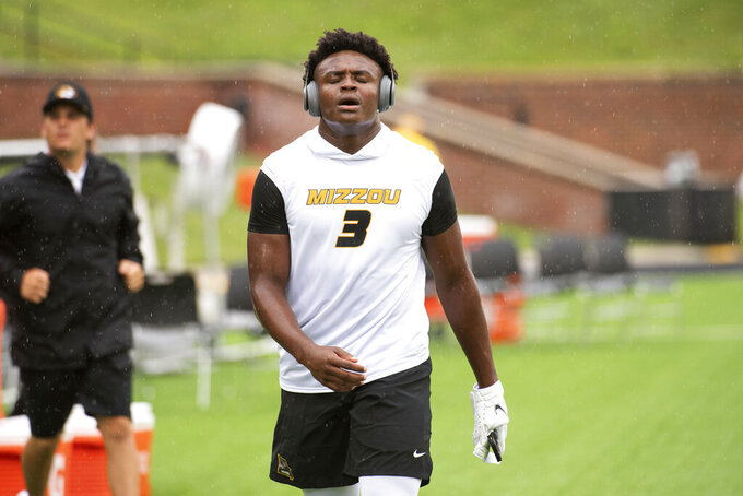 Missouri defensive back Martez Manuel warms up on the field in the rain before the start of an NCAA college football game against Central Michigan, Saturday, Sept. 4, 2021, in Columbia, Mo. (AP Photo/L.G. Patterson)