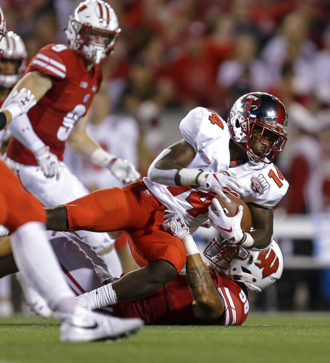 Wisconsin linebacker Zack Baun, bottom, tackles Western Kentucky running back Garland LaFrance during the first half of an NCAA college football game Friday, Aug. 31, 2018, in Madison, Wis. (AP Photo/Andy Manis)