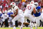 Nebraska quarterback Adrian Martinez (2) dodges Buffalo tackles for a 71-yard run during the first half of an NCAA college football game, Saturday, Sept. 11, 2021, at Memorial Stadium in Lincoln, Neb. (AP Photo/Rebecca S. Gratz)