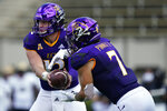 East Carolina quarterback Holton Ahlers (12) hands off to running back Darius Pinnix Jr. (7) during the first half of an NCAA college football game against Central Florida in Greenville, N.C., Saturday, Sept. 26, 2020. (AP Photo/Gerry Broome)