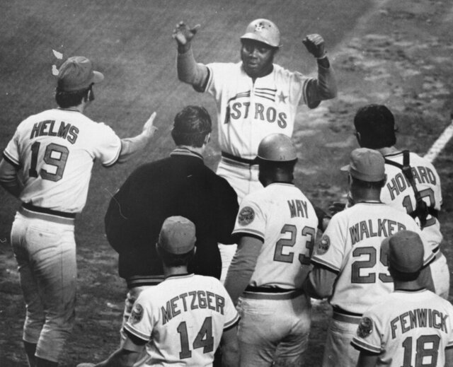 "FILE - In this 1972 file photo, Houston Astros' Jimmy Wynn, top, is greeted at the plate after a home run in a baseball game in Houston. Wynn, the slugger who earned his nickname of ""The Toy Cannon"" during his days with the Astros in the 1960s and '70s, has died. Wynn was 78. The Astros said he died on Thursday, March 26, 2020, in Houston, but did not provide further details. (Blair Pittman/Houston Chronicle via AP)"