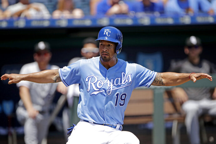 Kansas City Royals' Cheslor Cuthbert looks for an escape as he is caught off base trying to score on a fielder's choice hit into by Jorge Soler during the first inning of a baseball game against the Chicago White Sox Thursday, July 18, 2019, in Kansas City, Mo. Cuthbert was tagged out on the play. (AP Photo/Charlie Riedel)
