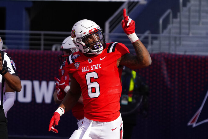 Ball State wide receiver Yo'Heinz Tyler reacts after scoring a touchdown against San Jose State during the second half of the Arizona Bowl NCAA college football game Thursday, Dec. 31, 2020, in Tucson, Ariz. Ball State won 34-13. (AP Photo/Rick Scuteri)