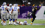 Appalachian State defensive lineman Okon Godwin (47) celebrates after sacking Middle Tennessee quarterback Brent Stockstill, on ground, in the second half of the New Orleans Bowl NCAA college football game in New Orleans, Saturday, Dec. 15, 2018. Appalachian State won 45-13. (AP Photo/Gerald Herbert)