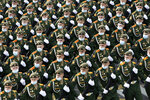 Russian soldiers wearing face masks to protect against coronavirus, march toward Red Square to attend a dress rehearsal for the Victory Day military parade in Moscow, Russia, Saturday, June 20, 2020. The military parade marking the 75th anniversary of the Nazi defeat was postponed from May 9 due to the outbreak of the coronavirus pandemic and is now set to take place on June 24. (AP Photo/Alexander Zemlianichenko)