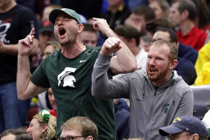 Michigan State fans cheer during the second half of an NCAA college basketball game between Michigan State and Wisconsin in the semifinals of the Big Ten Conference tournament, Saturday, March 16, 2019, in Chicago. Michigan State won 67-55. (AP Photo/Nam Y. Huh)