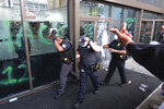 EDS NOTE: GRAPHIC CONTENT - Police react to protesters in Atlanta on May 29, 2020. Protesters carried signs and chanted their messages of outrage over the death of George Floyd in Minneapolis. (Ben Gray/Atlanta Journal-Constitution via AP)