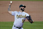 Oakland Athletics starting pitcher Mike Fiers throws to a Los Angeles Dodgers batter during the first inning of a baseball game Thursday, Sept. 24, 2020, in Los Angeles. (AP Photo/Marcio Jose Sanchez)
