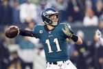 Philadelphia Eagles quarterback Carson Wentz throws a pass during the first half of an NFL football game against the Dallas Cowboys Sunday, Dec. 22, 2019, in Philadelphia. (AP Photo/Michael Perez)