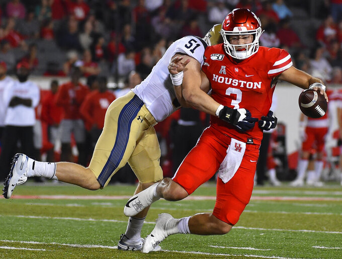 Houston quarterback Clayton Tune (3) is sacked by Navy linebacker Paul Carothers during the first half of an NCAA college football game, Saturday, Nov. 30, 2019, in Houston. (AP Photo/Eric Christian Smith)