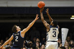 Butler guard Kamar Baldwin (3) shoots the game-winning basket over Villanova guard Collin Gillespie (2) in the second half of an NCAA college basketball game in Indianapolis, Wednesday, Feb. 5, 2020. Butler won 79-76. (AP Photo/AJ Mast)