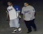 This frame grab from surveillance video provided by the Kansas City, Kan. Police Department shows two suspects authorities are looking for in connection with a fatal shooting at a bar early Sunday, Oct. 6, 2019, in Kansas City. (Courtesy of Kansas City, Kan. Police Department via AP)