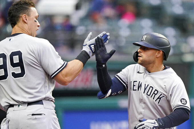 New York Yankees' Rougned Odor, right, is congratulated by Aaron Judge after Odor hit a solo home run in the fifth inning of a baseball game against the Cleveland Indians, Saturday, April 24, 2021, in Cleveland. (AP Photo/Tony Dejak)