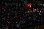 Pro-Beijing supporters wave the Chinese national flags during a rally in Hong Kong on Saturday, Dec. 7, 2019. Six months of unrest have tipped Hong Kong's already weak economy into recession. (AP Photo/Mark Schiefelbein)