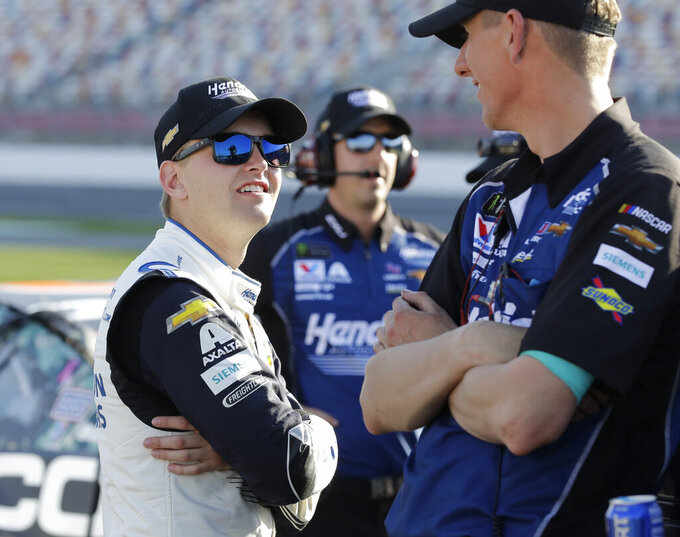 Alex Bowman, left, talks with cree members before qualifying for Saturday's NASCAR All-Star Cup series auto race at Charlotte Motor Speedway in Concord, N.C., Friday, May 17, 2019. (AP Photo/Chuck Burton)