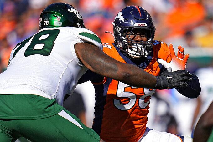 Denver Broncos outside linebacker Von Miller (58) battles New York Jets offensive tackle Morgan Moses (78) during the second half of an NFL football game, Sunday, Sept. 26, 2021, in Denver. (AP Photo/Jack Dempsey)