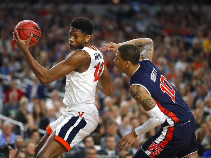 Virginia guard De'Andre Hunter, left, drives around Auburn guard Samir Doughty during the first half in the semifinals of the Final Four NCAA college basketball tournament, Saturday, April 6, 2019, in Minneapolis. (AP Photo/Jeff Roberson)