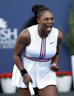 Serena Williams reacts during her match against Rebecca Peterson, of Sweden, at the Miami Open tennis tournament, Friday, March 22, 2019, in Miami Gardens, Fla. (AP Photo/Lynne Sladky)