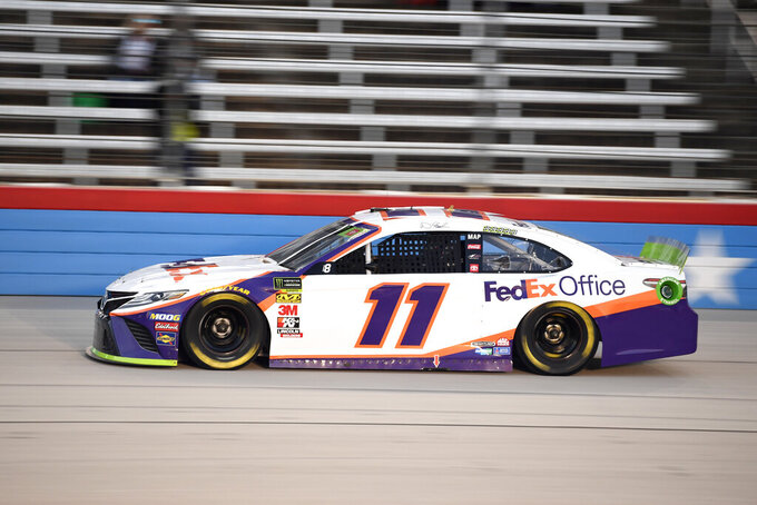 Denny Hamlin heads into the front stretch during qualifying for a NASCAR Cup Series auto race at Texas Motor Speedway in Fort Worth, Texas, Saturday, Nov. 2, 2019. (AP Photo/Larry Papke)