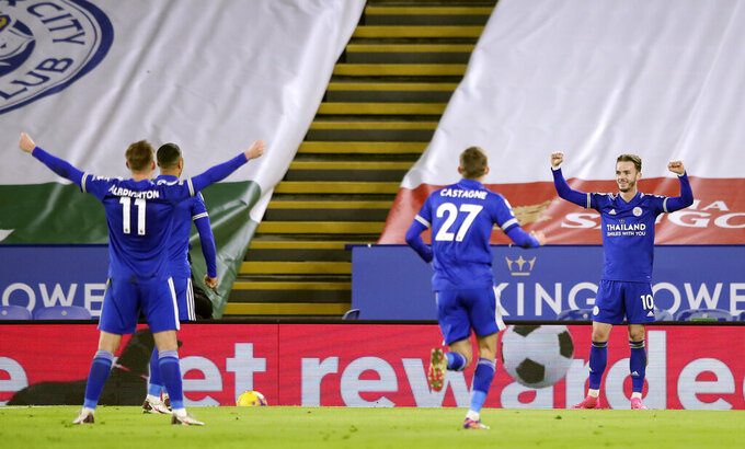 Leicester's James Maddison, right, celebrates after scoring the opening goal during the English Premier League soccer match between Leicester City and Southampton at the King Power Stadium in Leicester, England, Saturday, Jan. 16, 2021. (Alex Pantling/Pool via AP)