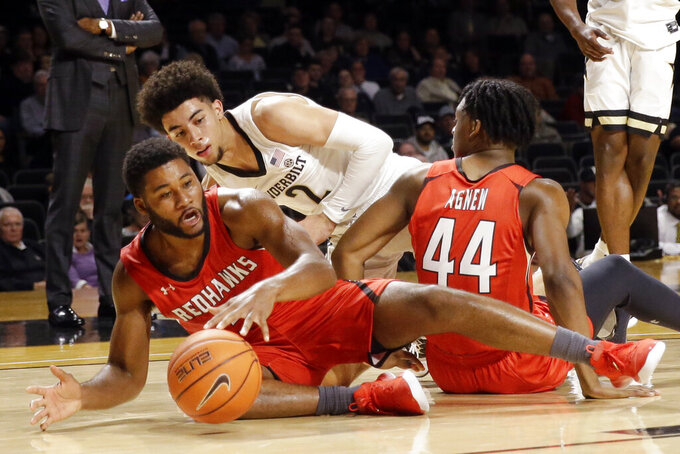 Southeast Missouri State guard Chris Harris, left, battles for a loose ball with forward Darrious Agnew (44) and Vanderbilt guard Scotty Pippen Jr. (2) in the second half of an NCAA college basketball game Wednesday, Nov. 6, 2019, in Nashville, Tenn. (AP Photo/Mark Humphrey)