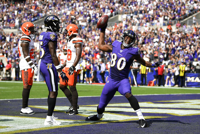 Baltimore Ravens wide receiver Miles Boykin (80) spikes the ball after catching a touchdown pass from quarterback Lamar Jackson during the first half of an NFL football game against the Cleveland Browns, Sunday, Sept. 29, 2019, in Baltimore. (AP Photo/Nick Wass)