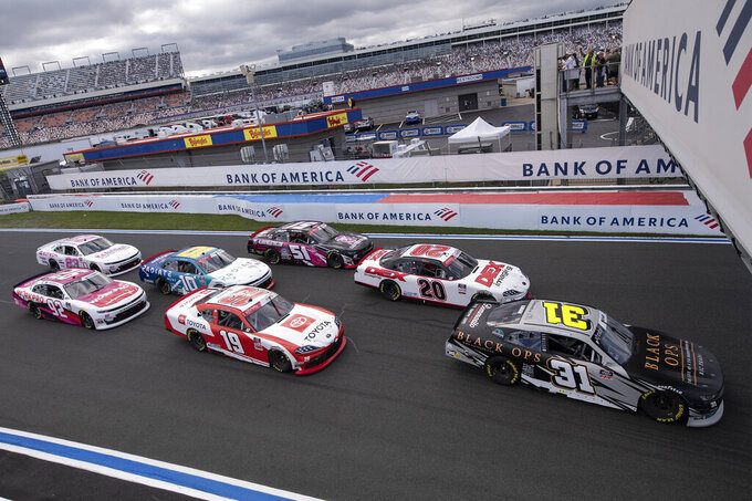 NASCAR Xfinity Series driver Sage Karam (31) leads a pack of cars during the NASCAR Xfinity auto race at the Charlotte Motor Speedway Saturday, Oct. 9, 2021, in Concord, N.C. (AP Photo/Matt Kelley)