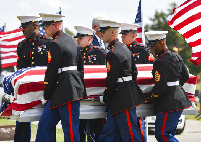 Marine honor guards carry Marine Cpl. Humberto Sanchez' casket during the graveside service at Mt. Hope Cemetery in Logansport, Ind., on Tuesday, Sept. 14, 2021. Sanchez was one of 13 U.S. service members killed in last month's suicide bombing at Afghanistan's Kabul airport during the U.S.-led evacuation.  (Jonah Hinebaugh/The Pharos-Tribune via AP)