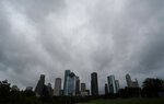 Clouds hover over downtown Houston ahead of Tropical Storm Imelda Tuesday, Sept. 18, 2019. The storm is forecast to bring heavy rainfall to the upper Texas coast over next few days. (AP Photo/David J. Phillip)