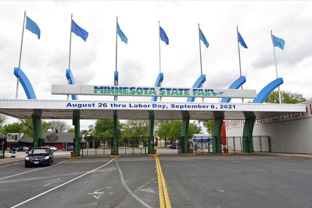 The dates for the 2021 Minnesota State Fair are displayed at the entrance in Falcon Heights, Minn. Friday, May 22, 2020, shortly after the 2020 Fair, scheduled for Aug. 27 to Labor Day, was cancelled due to the coronavirus pandemic. (AP Photo/Jim Mone)