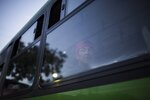 A Central American migrant who is traveling with a migrant caravan toward the U.S. border, peers from a bus window as he departs Guadalajara, Mexico, Tuesday, Nov. 13, 2018. The thousands of Central American migrants left shelters in Guadalajara early Tuesday and were taken by bus to a highway tollbooth to wait for rides to their next destination, however, no other buses showed up and few trucks passed to pick them up, leaving many to walk. (AP Photo/Rodrigo Abd)