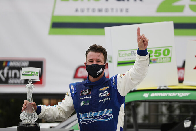 AJ Allmendinger celebrates after he won a NASCAR Xfinity Series auto race at Atlanta Motor Speedway, Saturday, June 6, 2020, in Hampton, Ga. (AP Photo/Brynn Anderson)