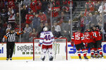 New Jersey Devils celebrate with center Blake Coleman, right, after he scored against New York Rangers goaltender Alexandar Georgiev (40) during the first period of an NHL hockey game Thursday, Oct. 17, 2019, in Newark, N.J. (AP Photo/Kathy Willens)