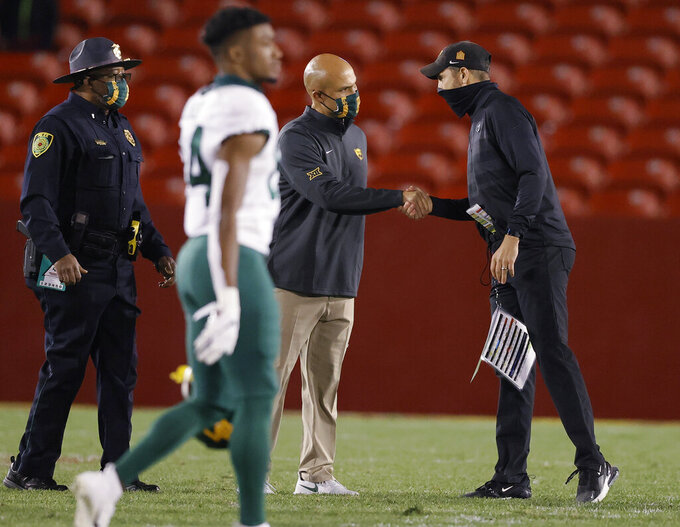 Baylor coach Dave Aranda, left, shakes hands with Iowa State coach Matt Campbell following Iowa State's 38-31 win in an NCAA college football game Saturday, Nov. 7, 2020, in Ames, Iowa. (AP Photo/Matthew Putney)