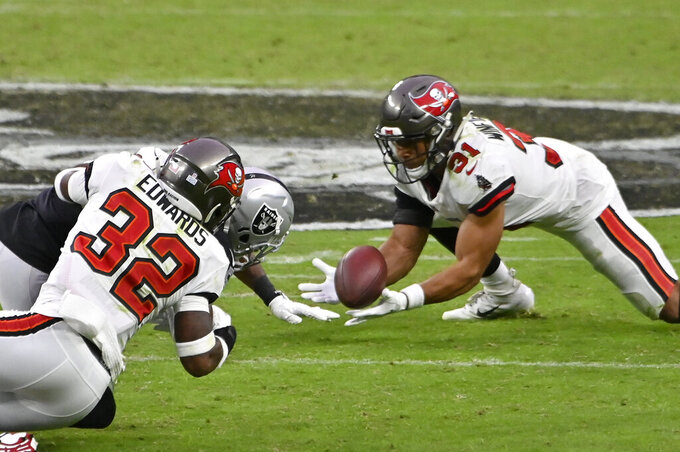 Tampa Bay Buccaneers strong safety Antoine Winfield Jr. (31) makes an interception against the Las Vegas Raiders during the second half of an NFL football game, Sunday, Oct. 25, 2020, in Las Vegas. (AP Photo/David Becker)