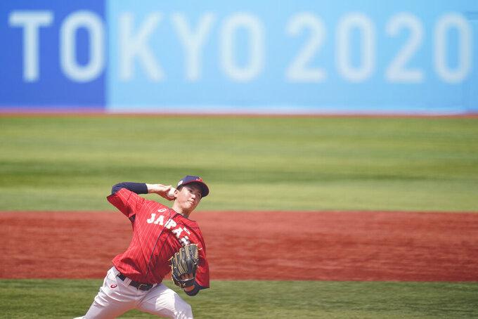 Japan's Masato Morishita pitches during a baseball game against Mexico at Yokohama Baseball Stadium during the 2020 Summer Olympics, Saturday, July 31, 2021, in Yokohama, Japan. (AP Photo/Matt Slocum)