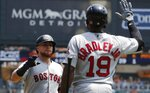 Boston Red Sox's Christian Vazquez, left, is greeted by Jackie Bradley Jr. after a two-run home run during the second inning of a baseball game against the Detroit Tigers, Sunday, July 7, 2019, in Detroit. (AP Photo/Carlos Osorio)