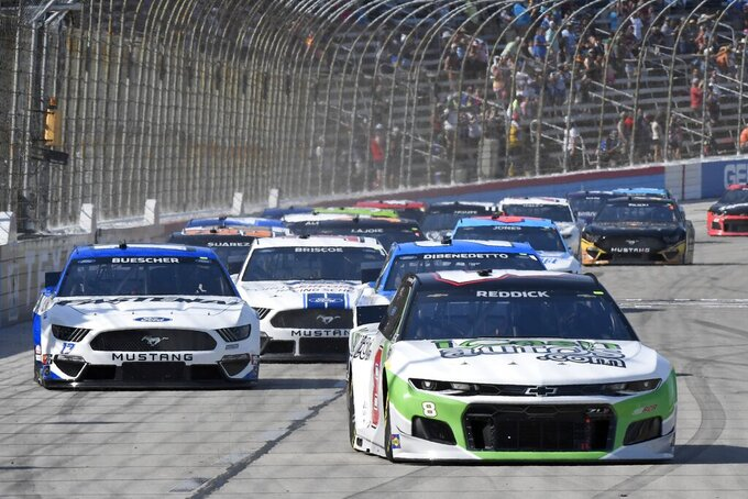 Tyler Reddick (8) leads the field into Turn 1 during the NASCAR All-Star Open Cup Series auto race at Texas Motor Speedway in Fort Worth, Texas, Sunday, June 13, 2021. (AP Photo/Larry Papke)