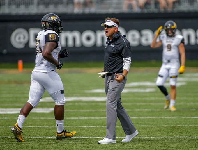 Towson coach Rob Ambrose talks to defensive linesman Bryce Carter in the first half of an NCAA college football game against Wake Forest in Winston-Salem, N.C., Saturday, Sept. 8, 2018. (AP Photo/Nell Redmond)