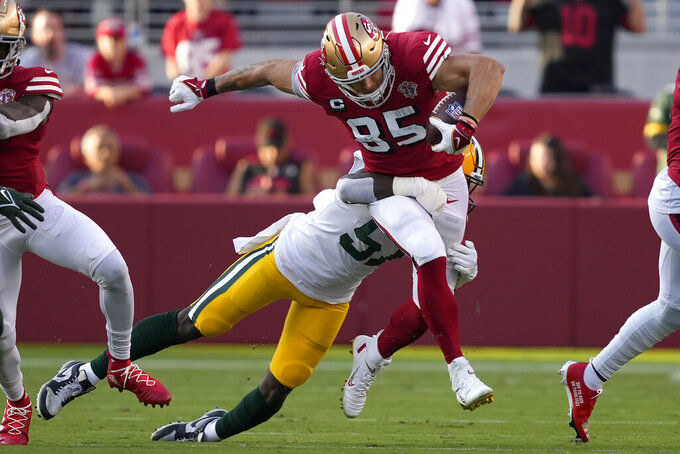 San Francisco 49ers tight end George Kittle (85) runs against Green Bay Packers linebacker Krys Barnes during the first half of an NFL football game in Santa Clara, Calif., Sunday, Sept. 26, 2021. (AP Photo/Tony Avelar)